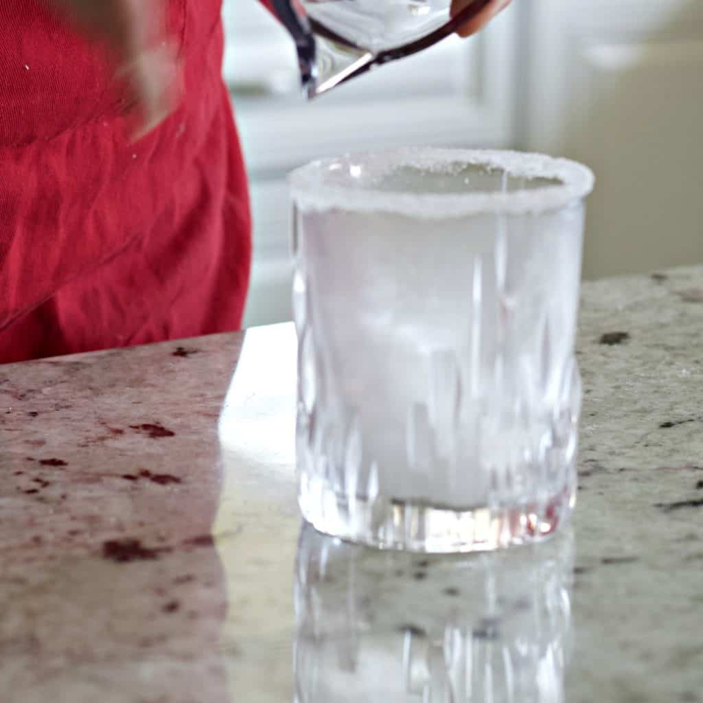 filling glass with ice.