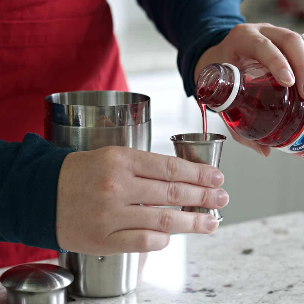Measuring Cranberry Juice.