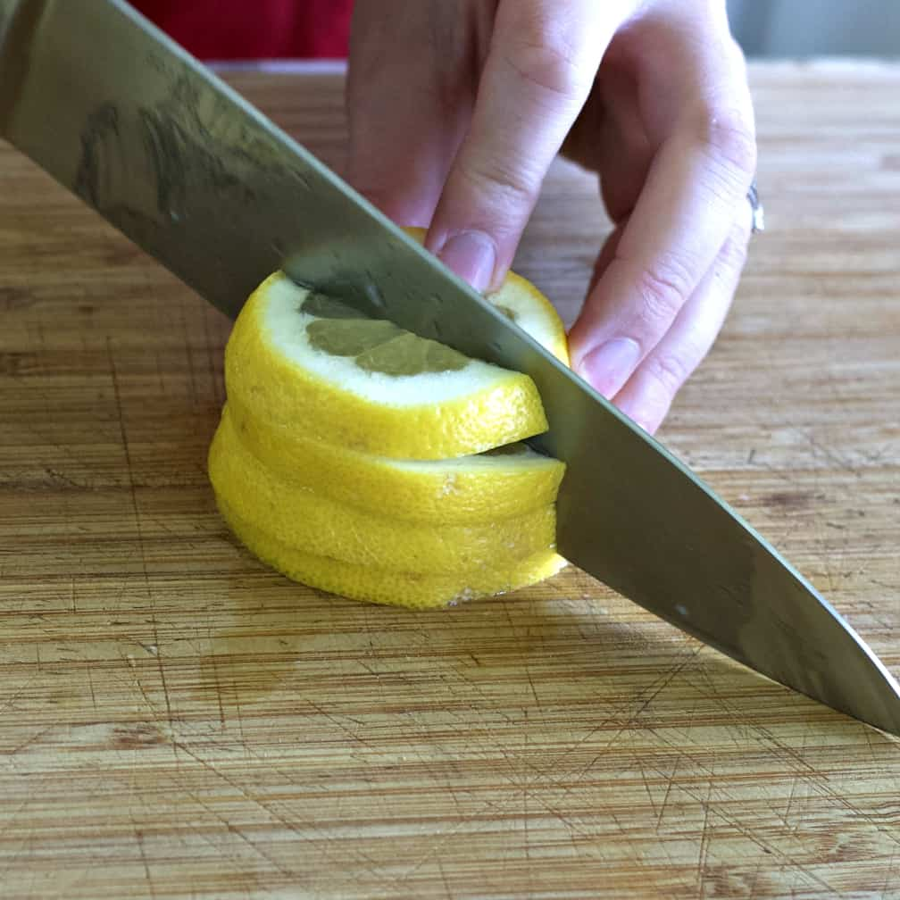 cutting lemons into  half slices