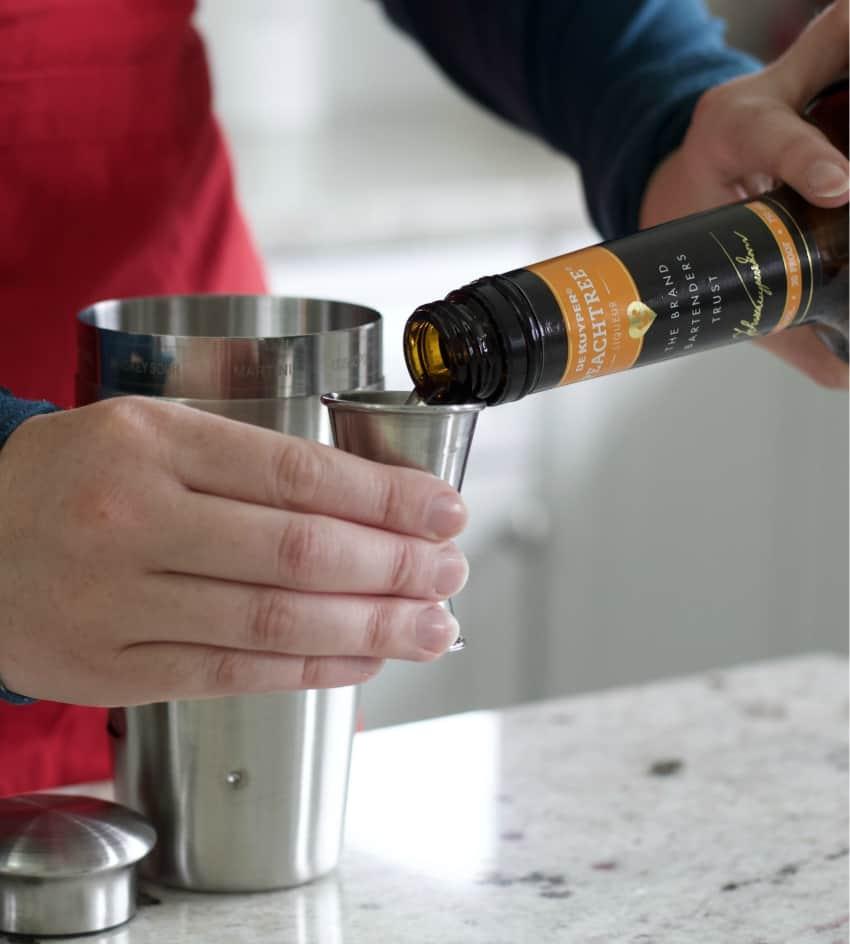 pouring peachtree liqueur