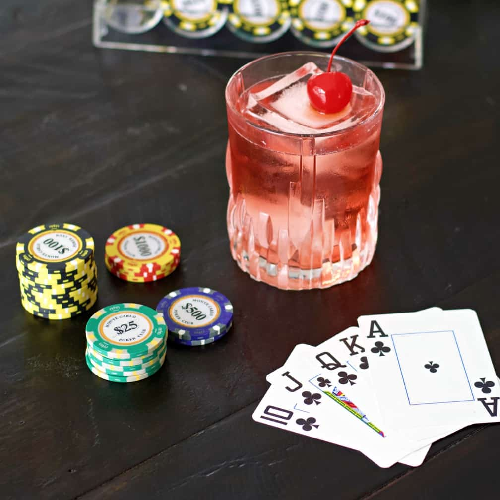 royal flush drink with poker chips and cards.