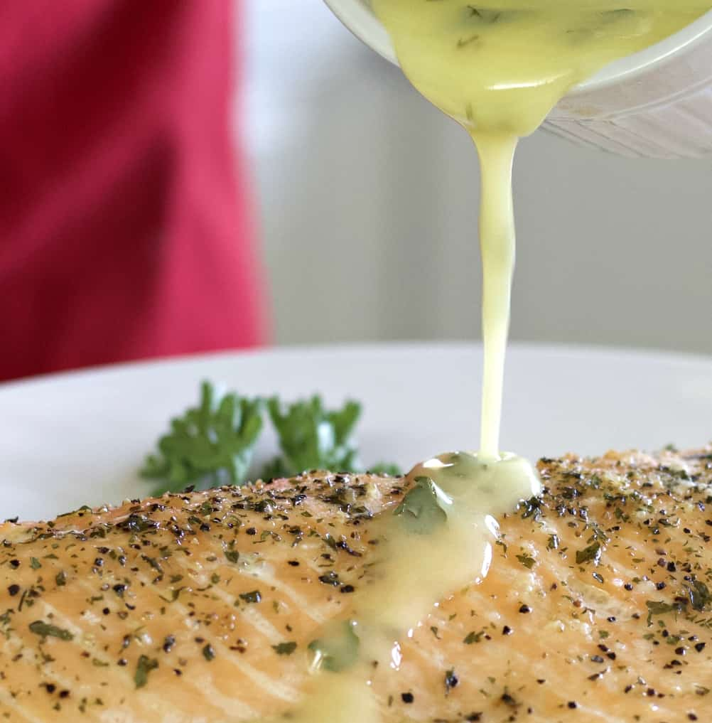 lemon butter sauce over baked salmon