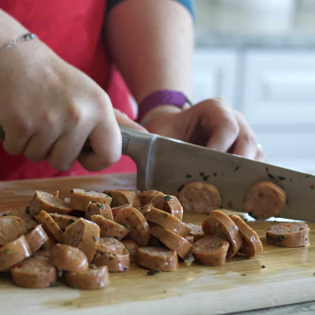 slicing chicken sausage
