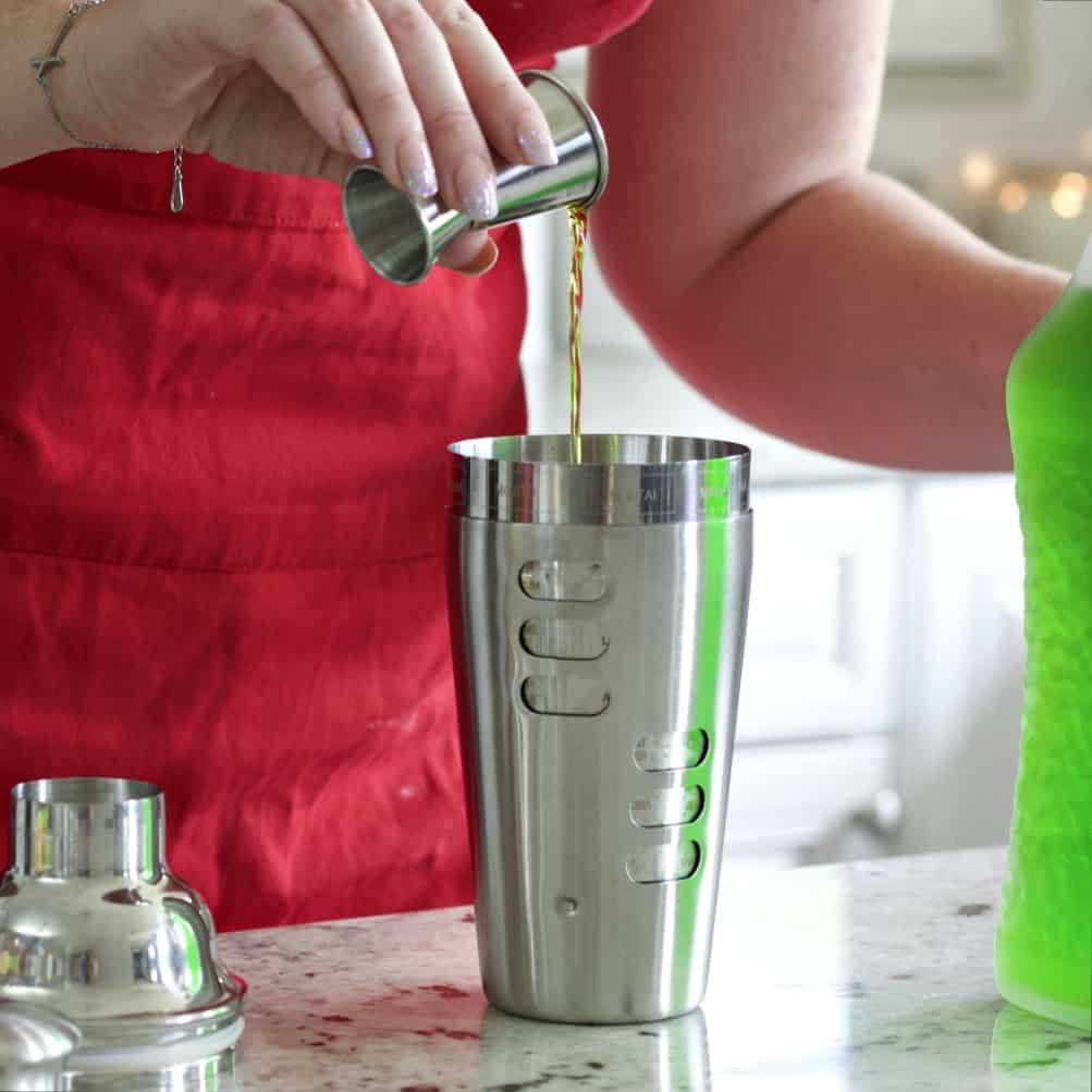 Pouring Midori For Midori Sour