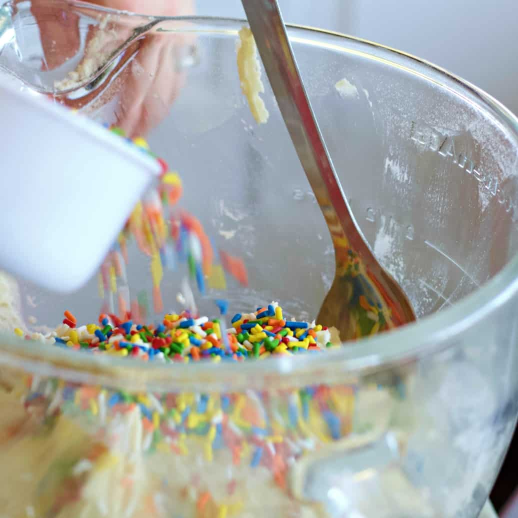 Adding sprinkles to cookies dough