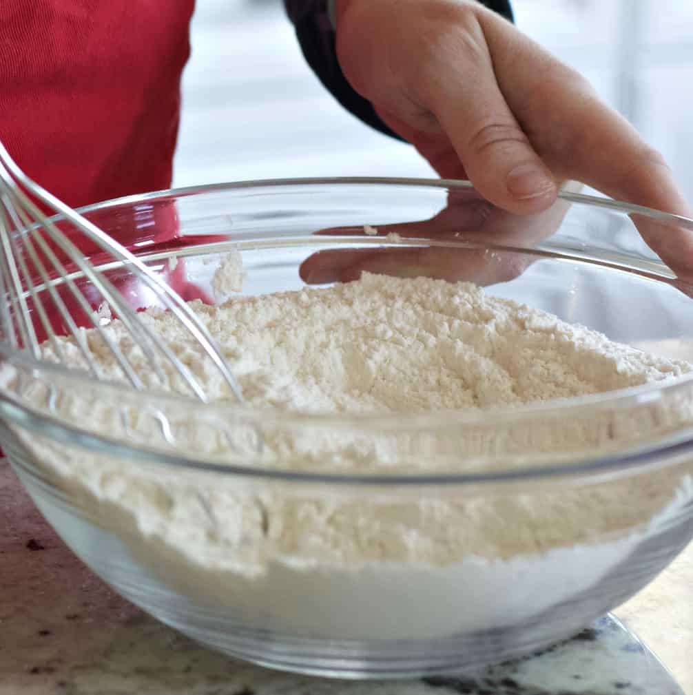 Whisking dry ingredients sprinkle cookies