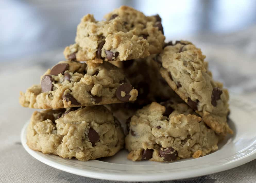 Peanut Butter Cookies With Oatmeal And Chocolate Mounded Together On A Plate