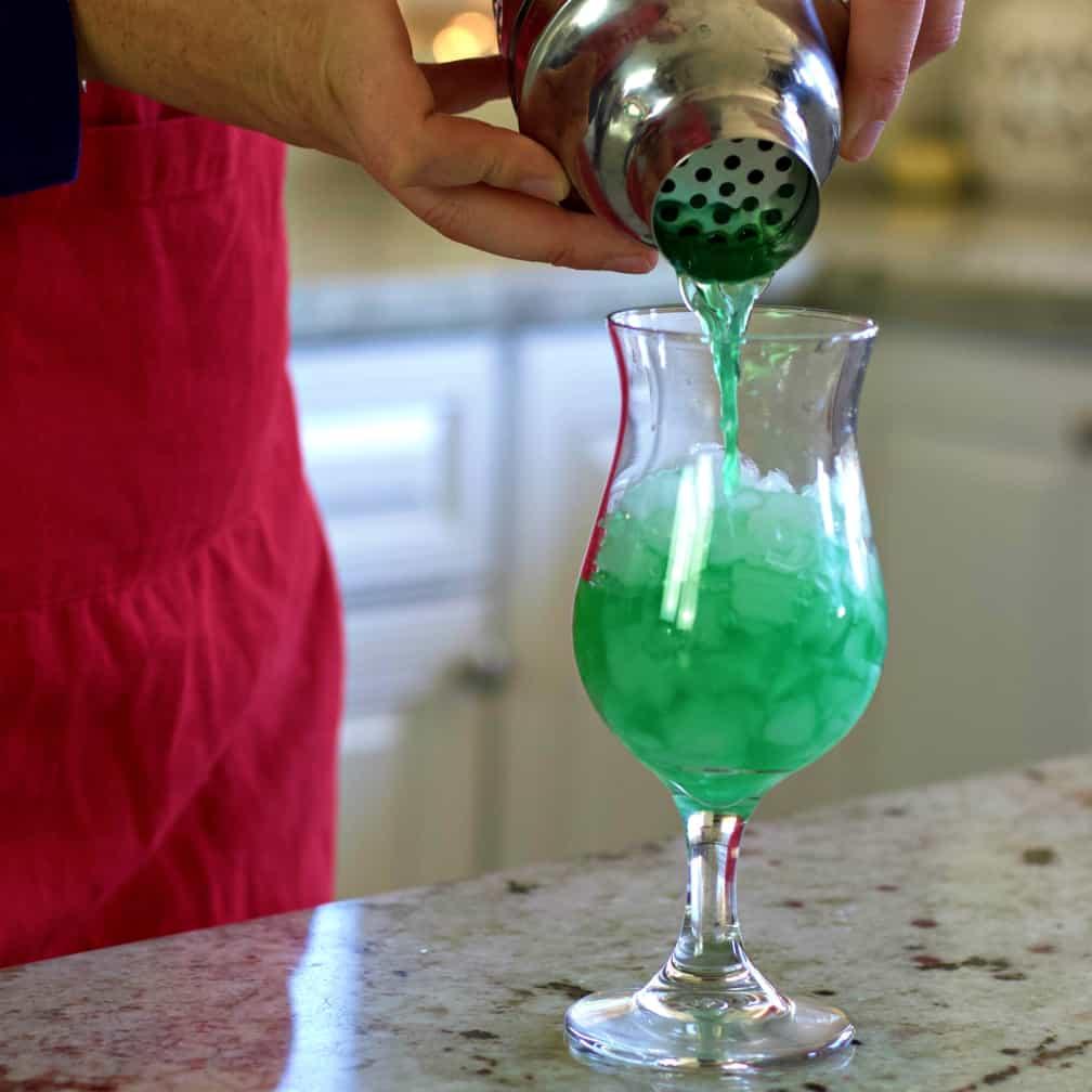 pouring liquid marijuana cocktail
