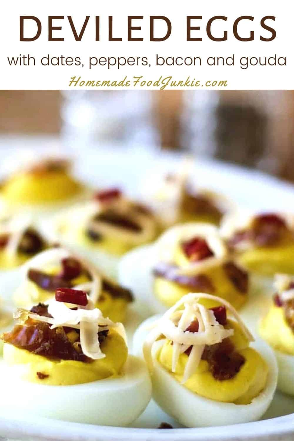 Deviled eggs with dates, peppers, bacon and gouda-pin image