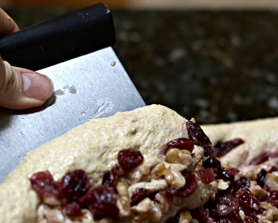 forming cranberry walnut sourdough bread.
