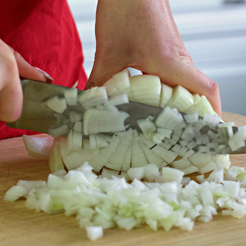 Dicing Onion-Egg Rolls In A Bowl