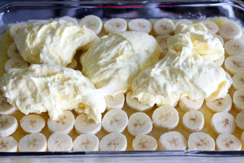 Spreading On Pudding Over Sliced Bananas