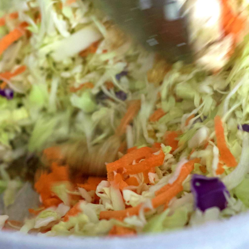 stirring egg rolls in a bowl