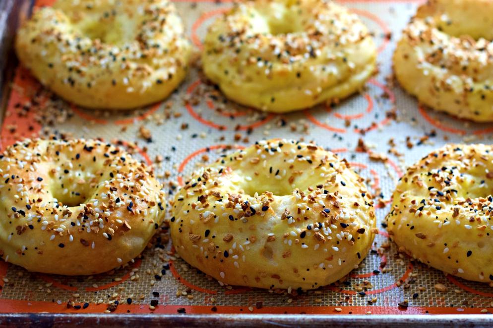 fresh baked bagels on baking sheet