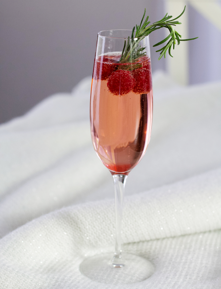 champagne cocktail on white throw