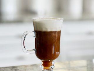 Irish coffee in a mug with whipped cream