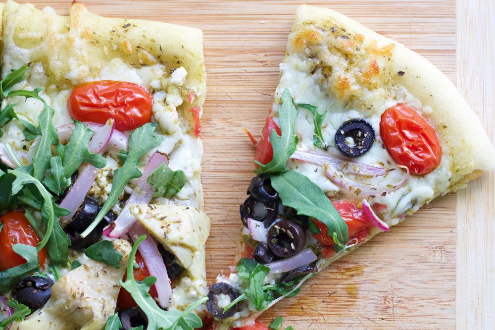 Flatbread With Mediterranean Toppings Cut Slice
