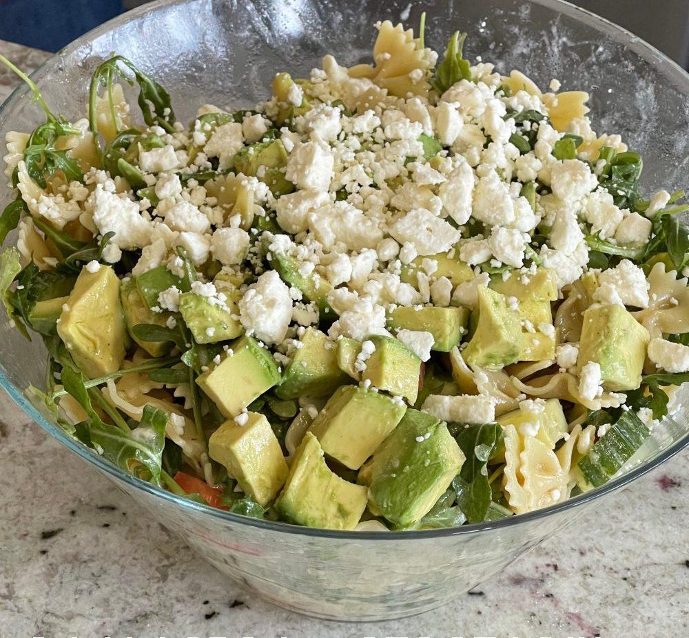 adding Feta and dressed chopped avocado