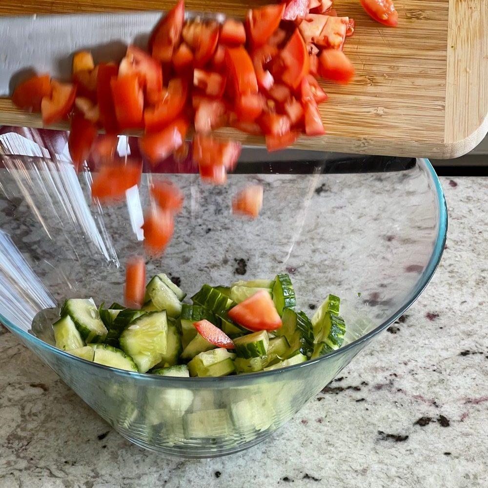 assembling Mediterranean pasta salad