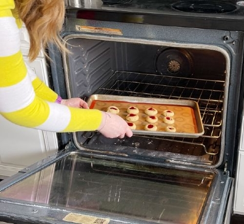Putting Cookies Into Oven To Bake