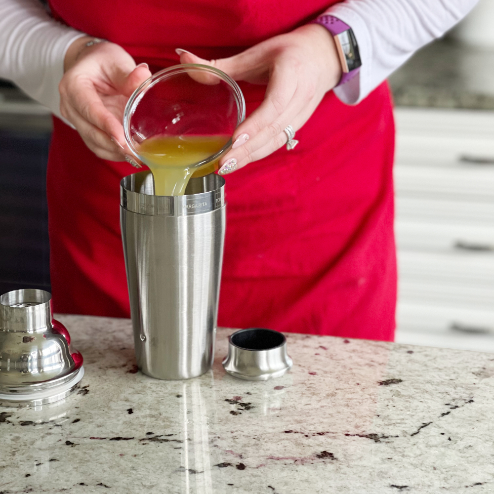 Pouring Juice Into A Shaker