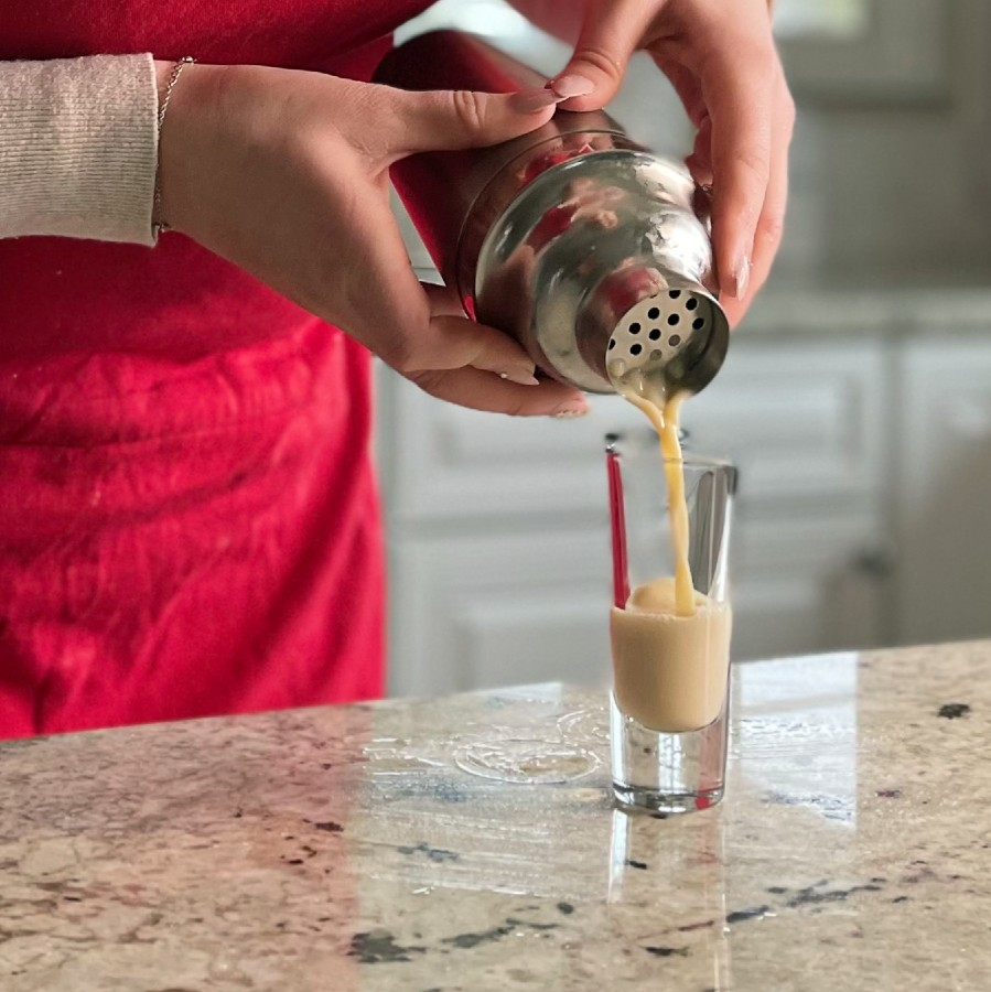 Pouring Butterscotch Shot Into Shot Glass