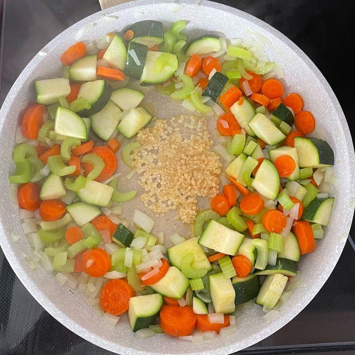 sauté vegetables in large pot