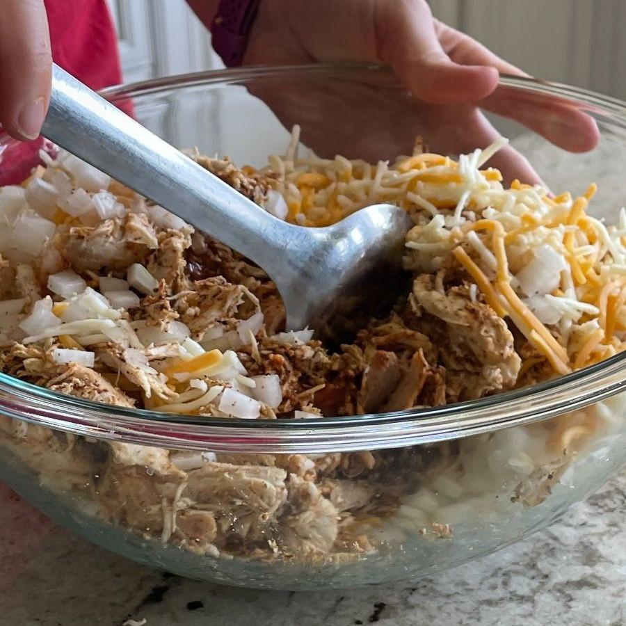 Stirring Completed Chicken Mixture-Chicken Enchilada Casserole