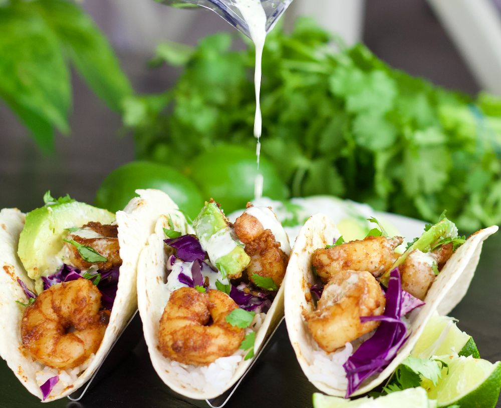 drizzling shrimp tacos with sauce