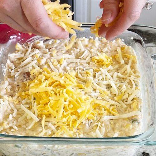 Sprinkling Cheese On Top-Corn Dip
