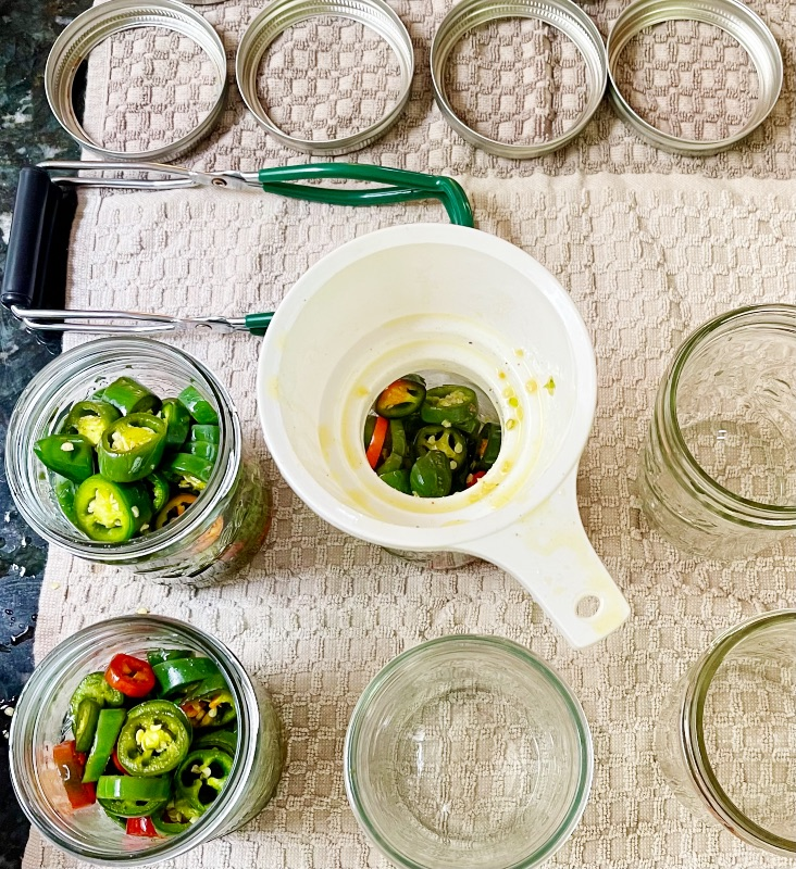 Filling Jars With A Canning Funnel-Candied Jalapenos